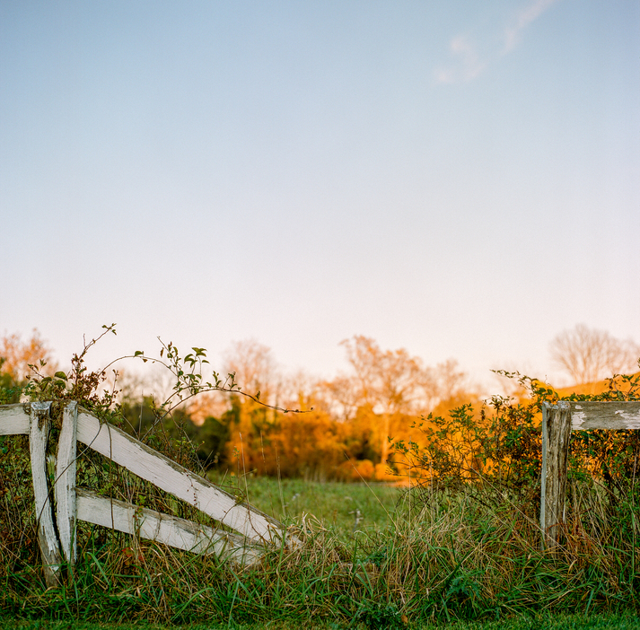 Fence In Disrepair At Sunset On An Autumn Evening.