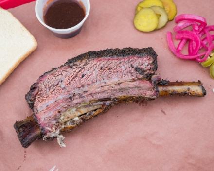 Massive Smoked Beef Rib On Butcher Paper.